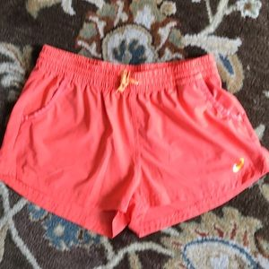 ASICS orange colored running shorts sz Medium